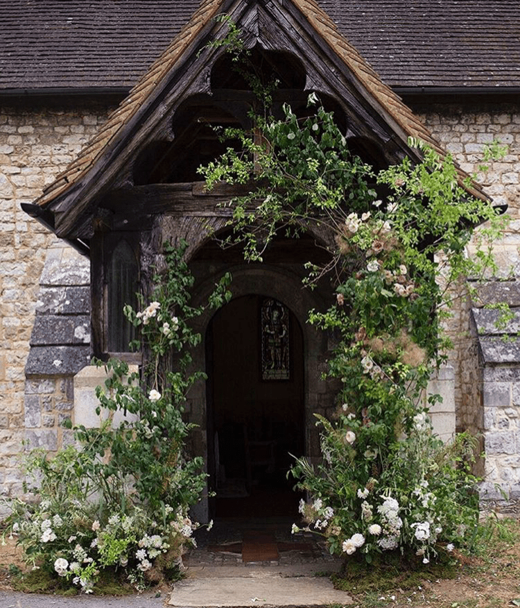 Fresh floral arch over doorway