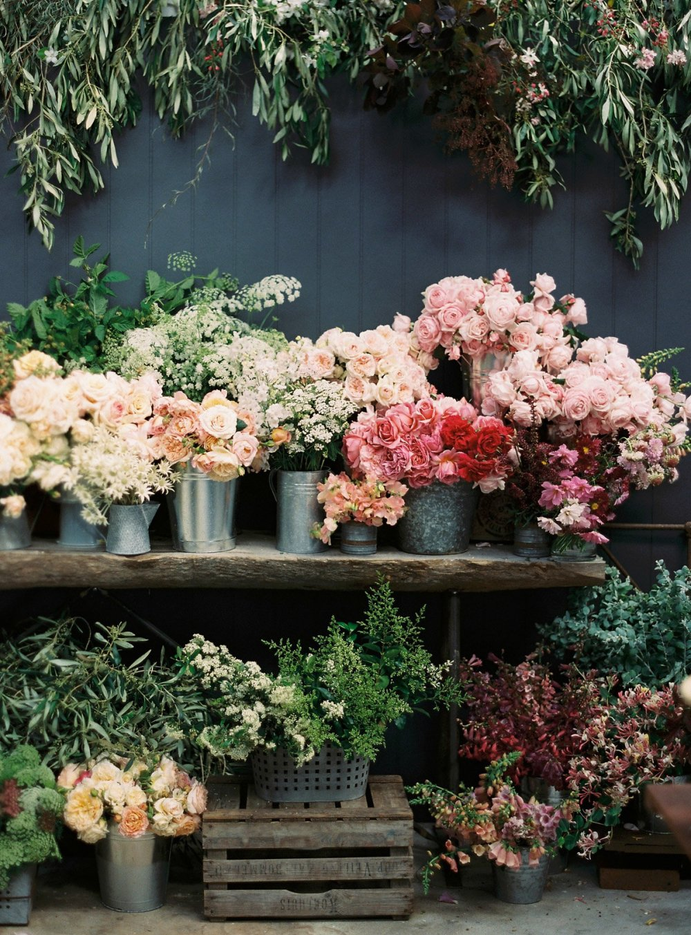 Many buckets of flowers
