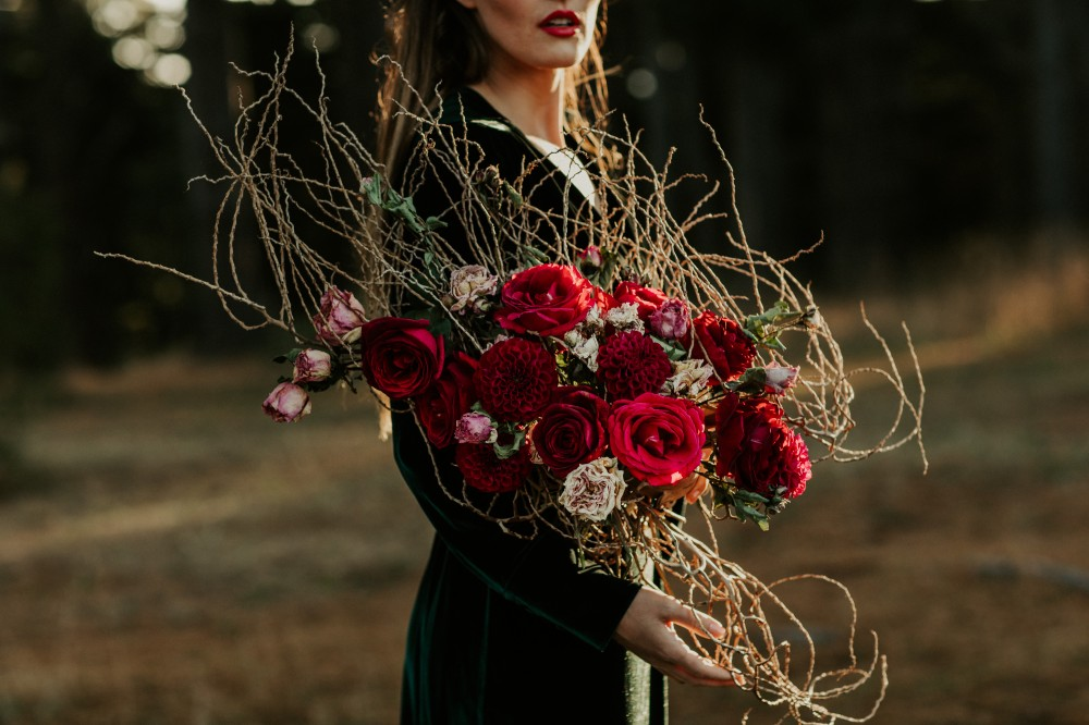 Red roses and twig bridal bouquet