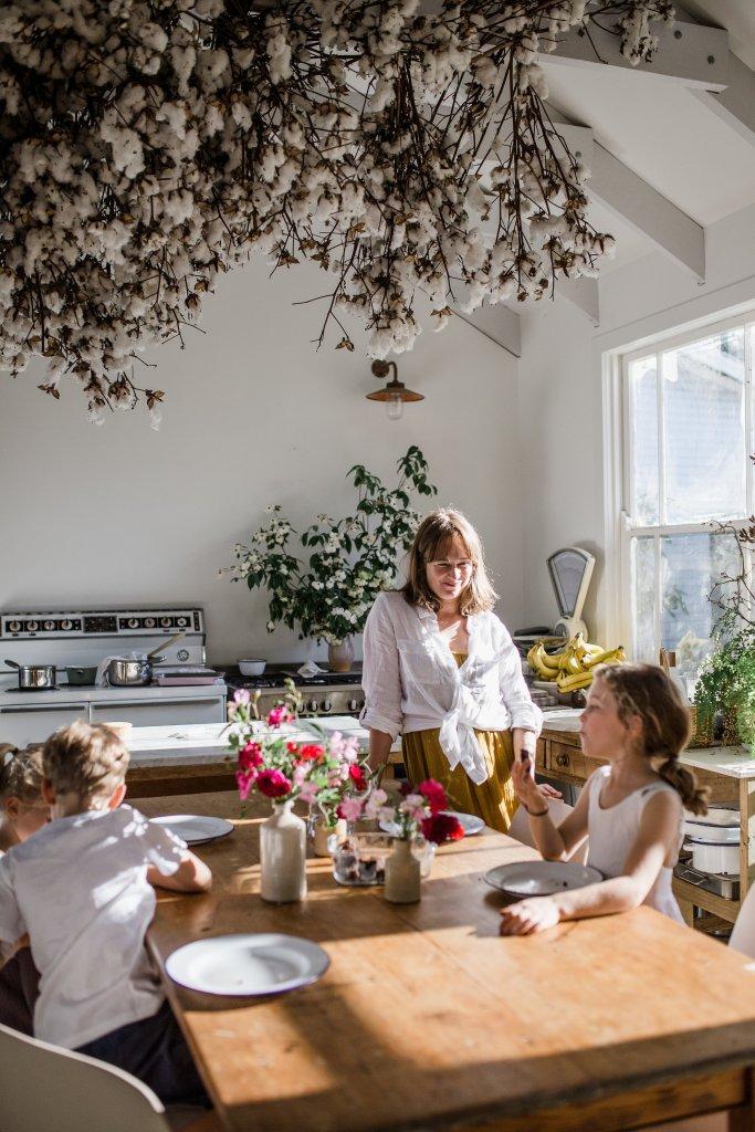 Annabelle Hickson in kitchen with kids